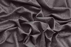 Brown silk damask fabric with wavy pattern Royalty Free Stock Photo