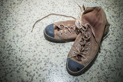 Brown silk shoes on floor Royalty Free Stock Image