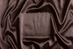 Brown silk textile background Stock Photography