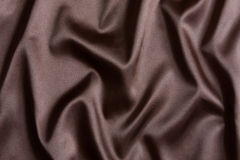 Brown silk textile background Royalty Free Stock Photo