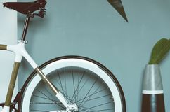 Brown and Silver and Black Hard Tail Bike Near Gray and Black Vase Royalty Free Stock Images