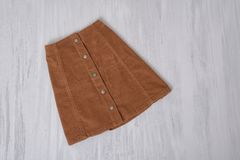 Brown skirt on a wooden background. Fashion concept.  royalty free stock photography