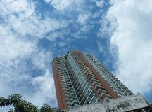 Condo on bottom view up to blue sky outdoors daytime royalty free stock photos