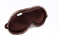 Brown sleeping mask on white Royalty Free Stock Images