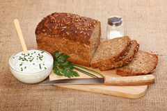 Brown sliced bread and spicy sour cream Stock Photo