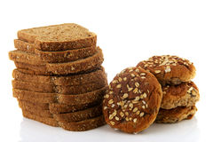 Brown slices bread and muesli bread rolls Royalty Free Stock Images