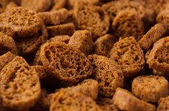 Brown slices rye croutons with blur as background, closeup. Brown slices rye croutons with blur as background, closeup Royalty Free Stock Photos