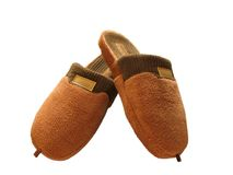 Brown slippers. A pair of brown slippers over white background Stock Photo