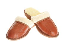 Brown slippers isolated on a white background. Royalty Free Stock Photo