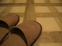 Brown Slippers on tile floor Royalty Free Stock Photo