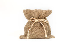 Brown small burlap bag with rope on white background Royalty Free Stock Photo
