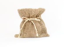 Brown small burlap bag with rope on white background Stock Images