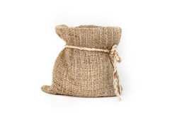 Brown small burlap bag with rope on white background Stock Photos