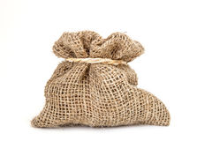 Brown small burlap bag with rope on white background Royalty Free Stock Photography
