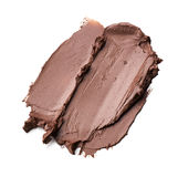 Brown smear paint of cosmetic products Stock Images