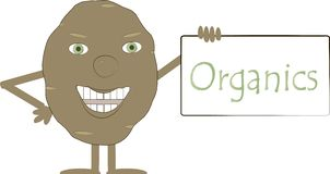 Brown smiling potato with green eyes and a sign of Organics Royalty Free Stock Photos