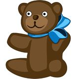 Brown teddy-bear with a big blue bow, isolated. Brown smiling teddy-bear with a big blue bow, isolated Royalty Free Stock Image