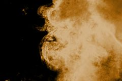 Brown smoke background. Brown dust particle exhale in the air royalty free stock photos