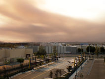 Brown smoke from wild fires. Reddish brown smoke from wild fires covers the sun and sky Stock Photography
