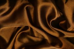 Brown smooth textile. As abstract background Stock Photos