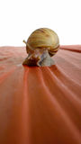 Brown Snail on Red Surface Stock Photos