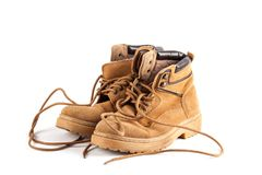 Brown sneaker on wood desk. Fashion background Royalty Free Stock Photo