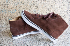Brown sneakers. One pair of jeans, an old form Royalty Free Stock Photo