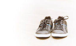 Brown sneakers with white bottom Royalty Free Stock Photography