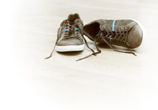 Brown sneakers with white bottom Royalty Free Stock Images