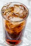 Brown soda. A glass of brown soda with ice cubes Royalty Free Stock Photo