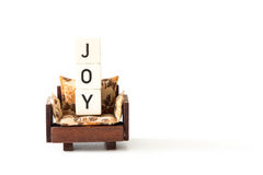 Brown sofa chair with letters joy concept on white background Royalty Free Stock Image