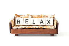 Brown sofa chair with letters relax concept Royalty Free Stock Images