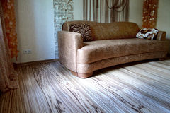 Brown sofa and colorful floor - Zebrano Stock Image