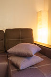 Brown sofa and a included lamp in the bedroom Royalty Free Stock Photos