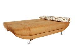 Brown sofa med isolerad tygupholstery Royaltyfria Foton