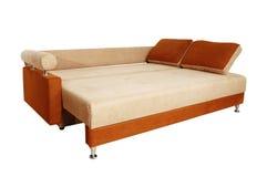 Brown sofa med isolerad tygupholstery Fotografering för Bildbyråer