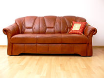 Brown sofa with orient pillow. Comfortable brown leather sofa with orient pillow Stock Photography