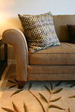 Brown Sofa and Pillow. Sturdy brown tweed sofa with patterned Royalty Free Stock Photography