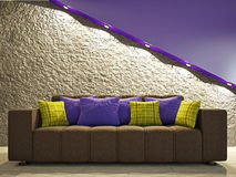 Sofa near the wall. Brown sofa with pillows near the brick wall Stock Photography