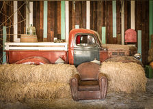 Brown sofa and red pickup inside the room Stock Photography