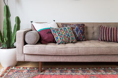 Brown sofa on rug royalty free stock images