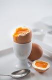 Brown soft-boiled open egg for breakfast Stock Photo