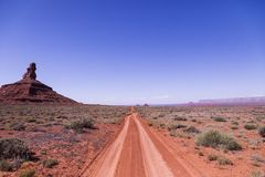 Brown Soil Road Under Clear Sky Stock Photo