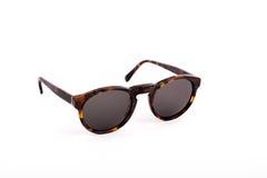 Brown solglasögon som isoleras på vit bakgrund Fotografering för Bildbyråer