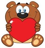 Brown sorridente Teddy Bear Cartoon Mascot Character che tiene Valentine Love Heart Royalty Illustrazione gratis