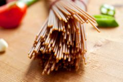 Brown spelt spaghetti Stock Photography