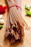 Brown spelt spaghetti Stock Photos