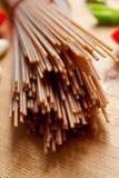 Brown spelt spaghetti Stock Images