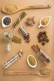 Brown spices on a brown background Royalty Free Stock Photos