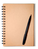 Brown Spiral and Black Pen Stock Image